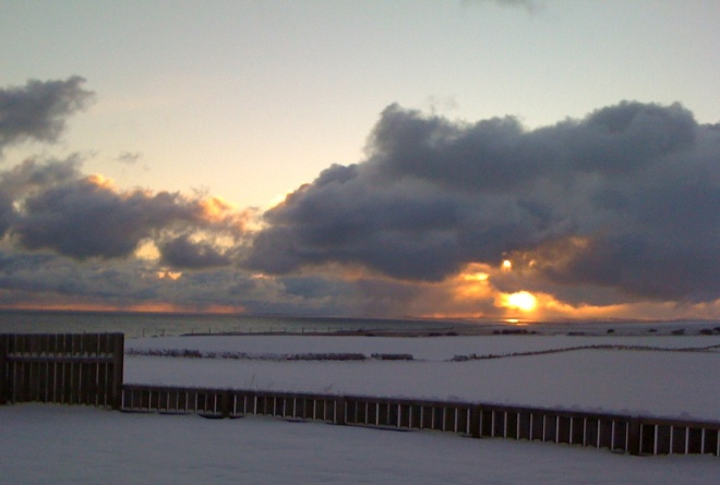 mean and moody sunrise over snow