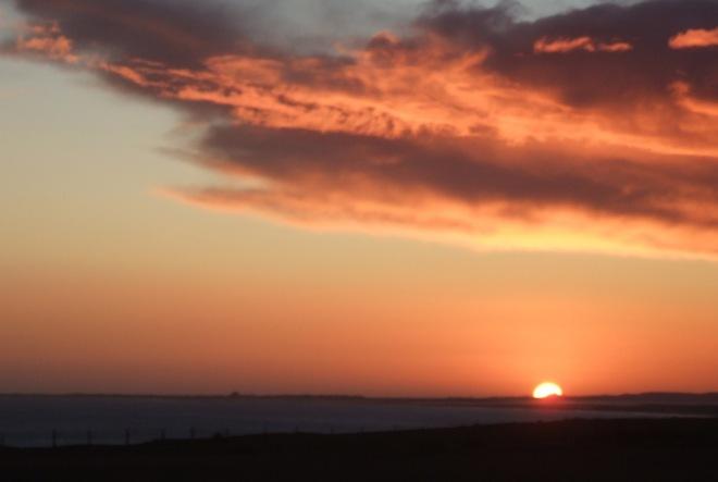 more furious sunrise behind Bamburgh castle