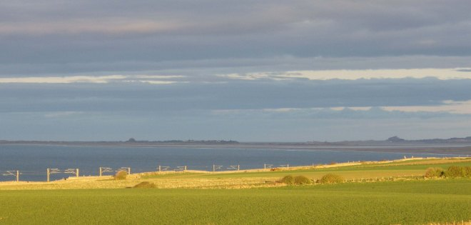 View of Lindisfarne and Bamburgh castles