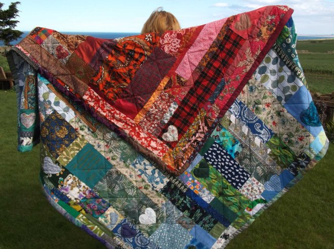 Katherine holding quilt wide