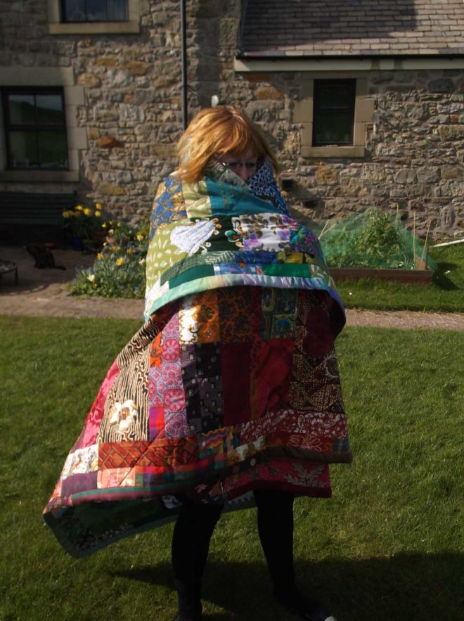 Katherine huddled up in quilt