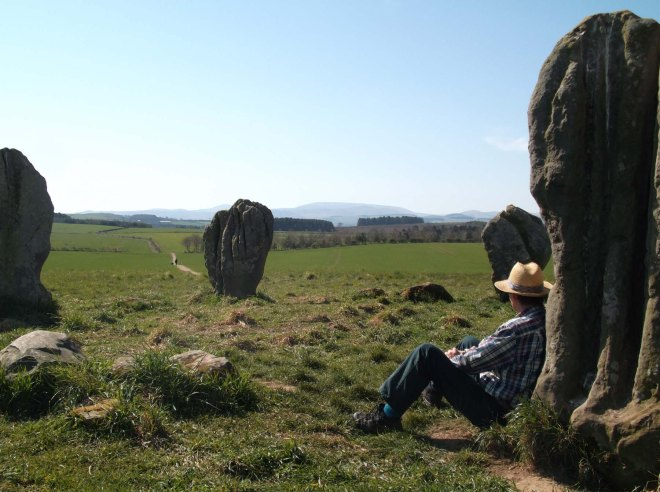 Stephen sitting against stone