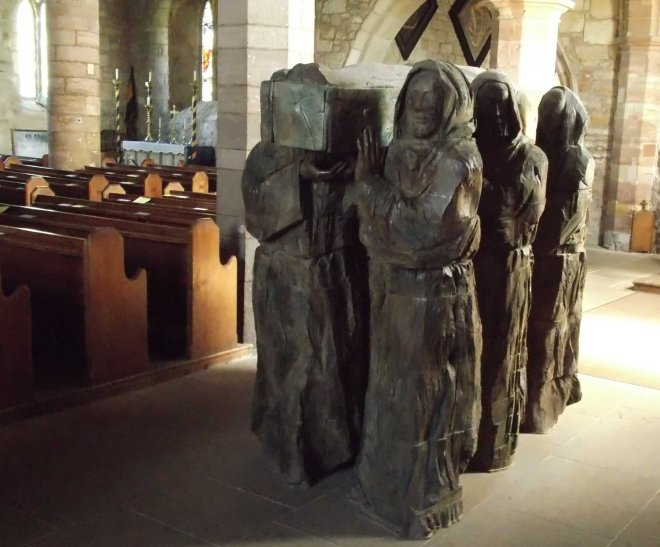 wood carving of monks carrying Cuthbert's body