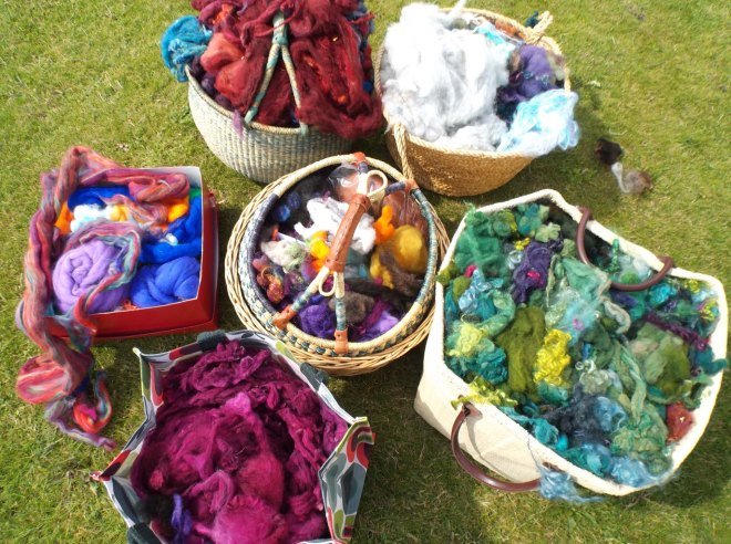Baskets of coloured fleece in garden