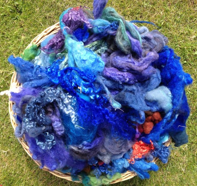 blue fleece in basket