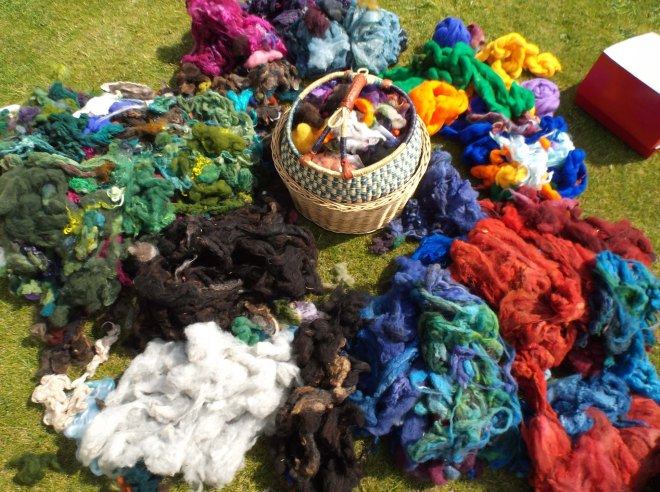centre basket and piles of coloured fleece on grass