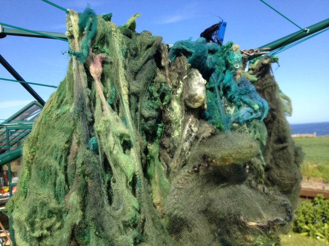 closeup of green fleece on washing line