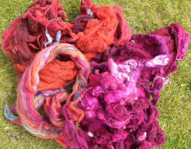 red orange pink fleece on grass