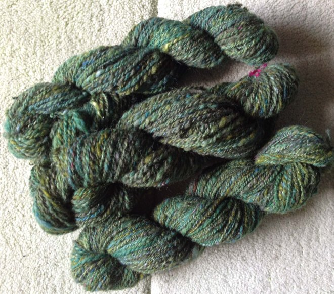 Spun green fleece hanks