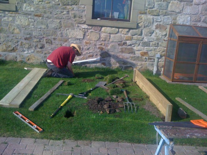 Stephen building the raised beds