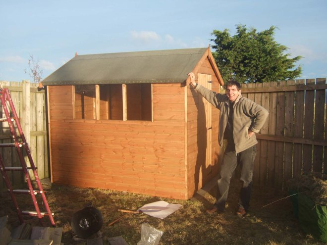 Stephen building the shed