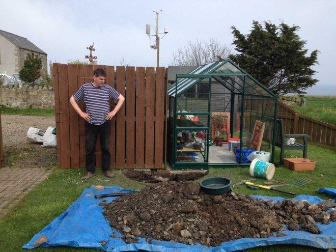 Stephen inspecting a newly dug holes