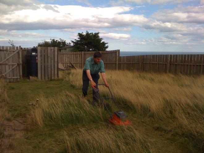 Stephen mowing wild garden