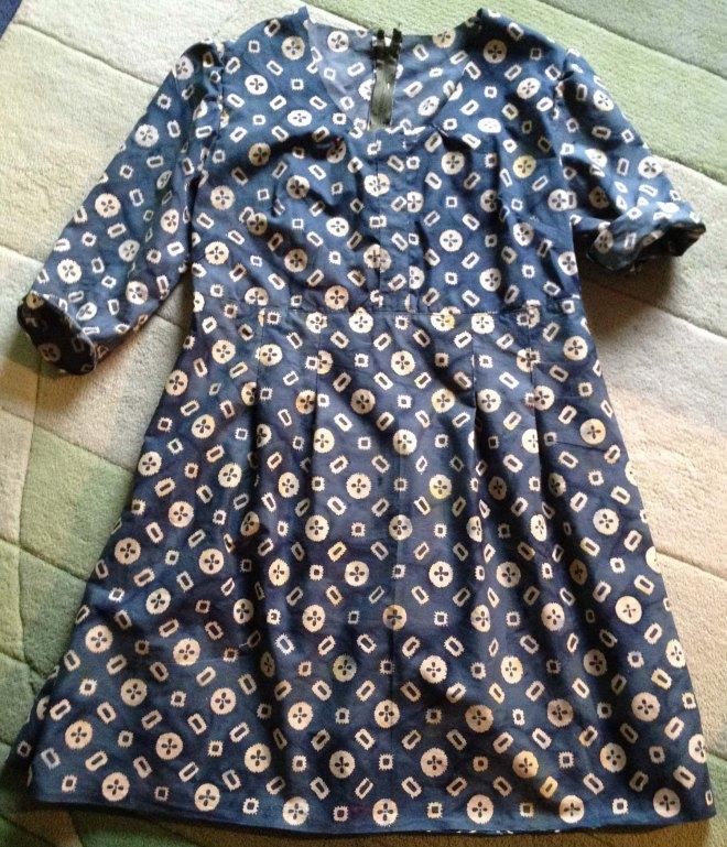 dress showing pleats in skirt