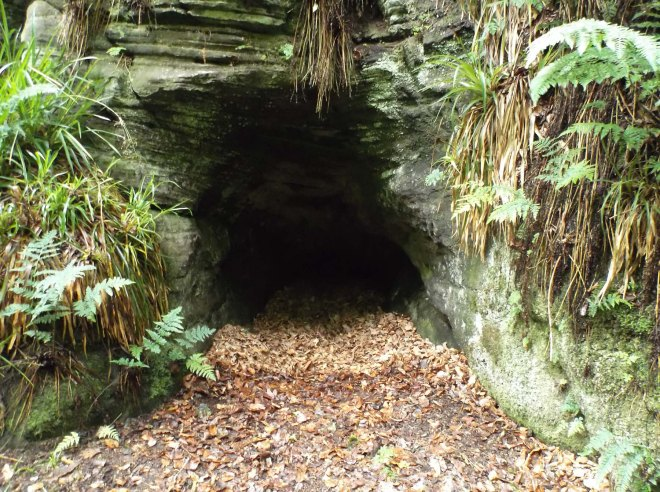 small cave near waterfall
