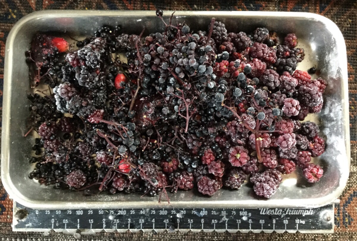 Berries from the freezer on the scales