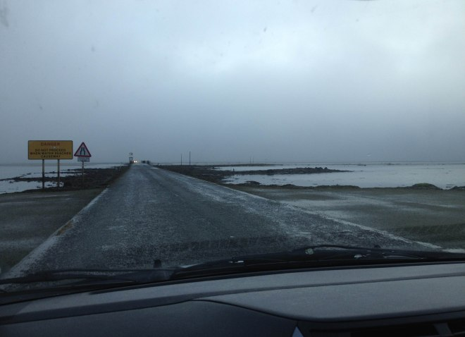 driving over a misty causeway