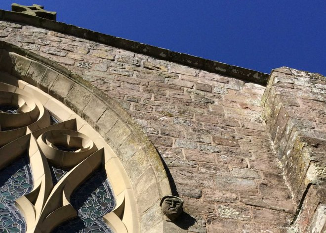 Ancient faces on Norham church
