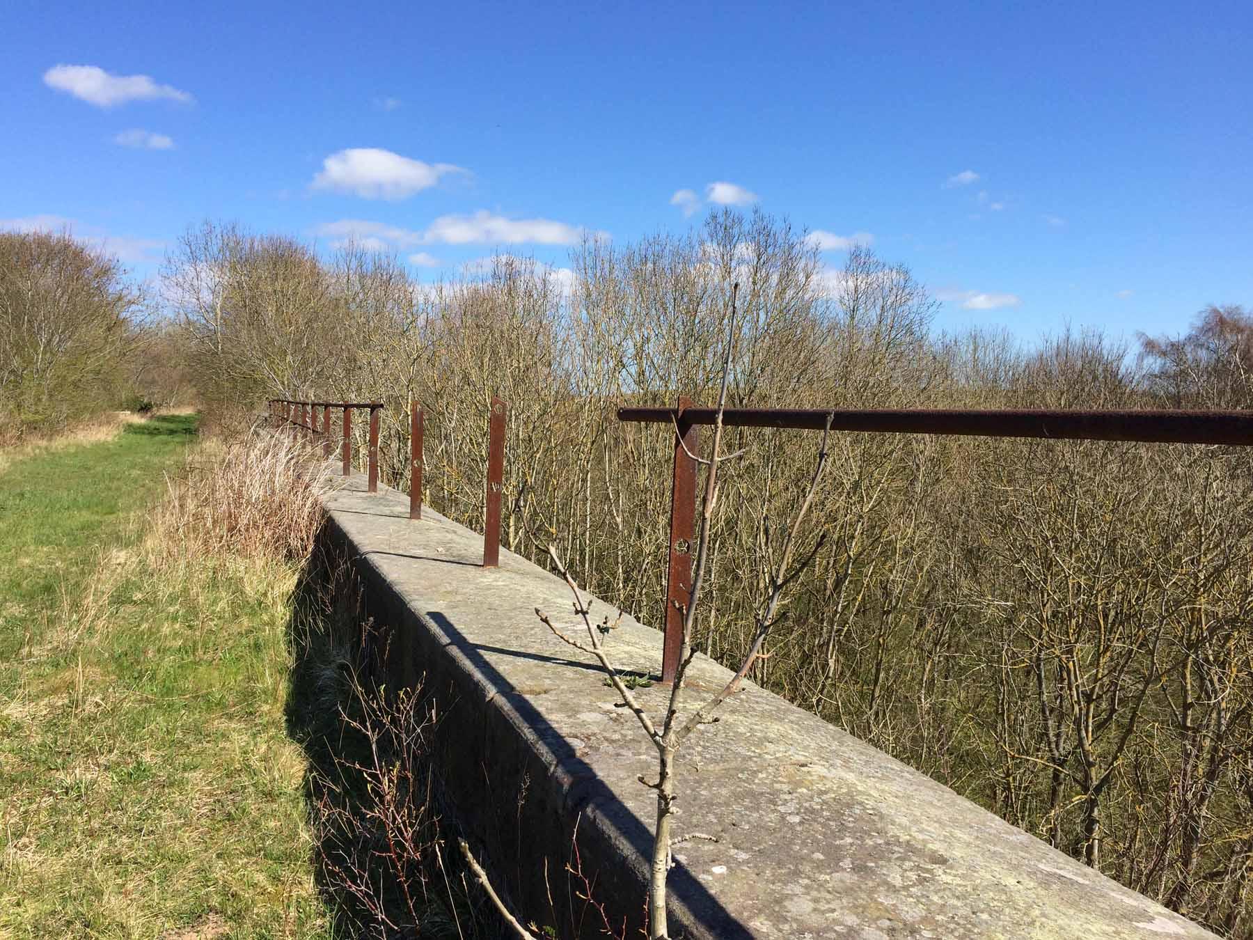 metal rails on bridge collapsing
