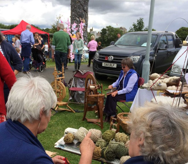 Tweed guild spinners outside tent