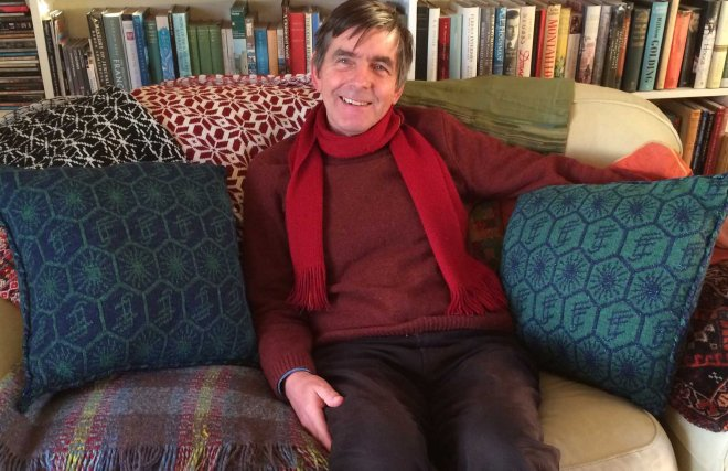 stephen-with-his-machine-knitted-cushions