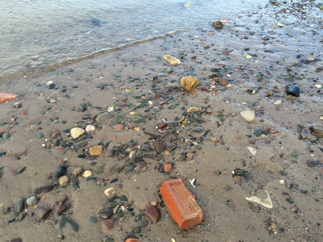 Finding bricks on the seashore