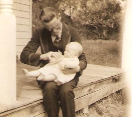 Graandfather WHGE feeding Dick 1926